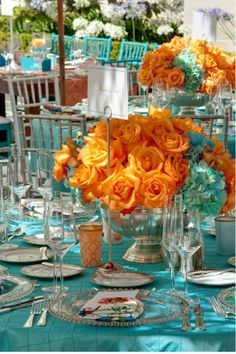 Orange and turquoise reception tables.