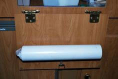 Pop Up Camper Remodel Ideas | PVC pipe garbage bag holder. Velcro-ed on to the door.