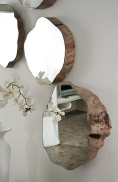 Mirror mounted to natural wood cuts - beautiful.