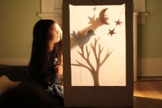 Shadow puppet theatre. Use a large cardboard box and tracing paper, regular white paper will probably work too. Need to stick a torch to a chair to get it to aim right