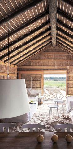 = sandy floored beach shack