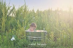 Baby in a bathtub...in a field...with bubbles.  I'll never get over the cutest of this <3