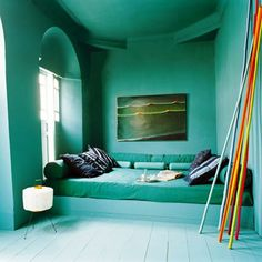 Immersing a room in rich color is a fantastic way to feel as if you're living inside a painting