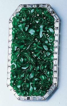 A carved jadeite and diamond brooch
