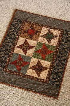 This would look great in modern fabrics with maybe a solid med grey background on 1/2 the squares and 1/2 in white.....:)