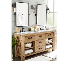 vanity and mirrors Benchwright Double Sink Console - Wax Pine finish | Pottery Barn and kensington pivot mirror