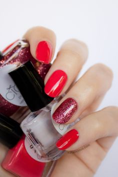 Beautiful red nails with accent glitter nail.