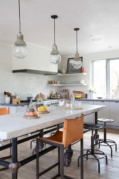 in love with this fresh take on an industrial kitchen