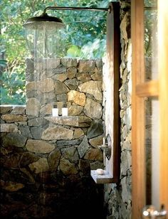 Outdoor shower with stone walls~