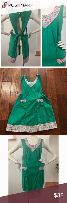 """Adorable Vintage Apron Vintage original apron. Green teal with flowers. Button in the back with an adorable peekaboo opening! Measures-36"""" Vintage Dresses"""