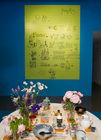 Eames Words at the A + D Museum.  A Charles Eames rebus overlooks a table setting inspired by Ray Eames