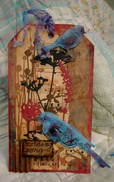 Tim Holtz and Spellbinders dies, old music, acrylics and Amazon shipping cardboard.
