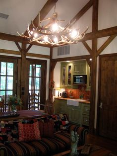 Texas Regional Design - living room and kitchen with antler chandelier, small living, small house