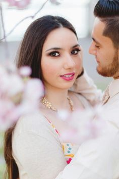 I think he's pretty smitten with this beauty. Couples portrait beneath the cherry blossoms at Tom McCall Waterfront Park Portland, OR