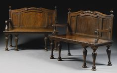 A pair of Early George III Mahogany Hall Benches circa 1760, Attributed to William and John Linnell each with a scrolled serpentine top rail centred by foliage and flanked by turned finials above a panelled back edged with foliate and bead-and-reel ornament, the scrolled arms with bead-and-reel edging above a solid seat with ribbon-and-rosette carved edge and a fluted frieze, on baluster legs headed with foliage and with guilloche carved bun feet,
