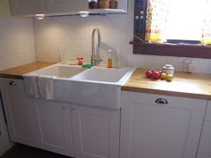Tin ceiling tiles as a kitchen backsplash.  I LOVE this sink!!!!