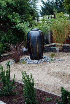 Bubbling Fountain In Gravel Patio