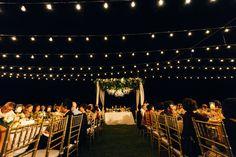 Beautifully strung light bulbs for an outdoor wedding // Jordan and Mercy's Elegant Bali Garden Wedding