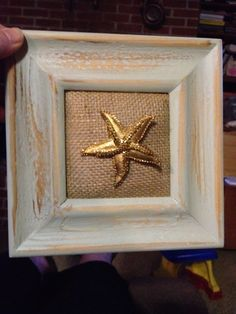 Vintage starfish pin framed on a repurposed frame with burlap mat