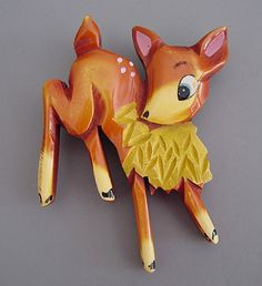 """BAKELITE carved, resin washed and painted deer brooch.  This is similar to the pieces shown on page 150 of Christie Romero's """"Warman's Jewelry"""", and is probably one of the Walt Disney """"Bambi"""""""