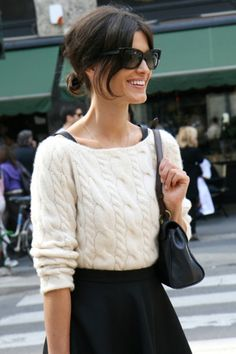 Cable knit sweater tucked into high waisted skirt + tights and leather boots