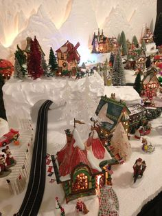 Train tracks and tunnel in my 2015 Department 56 North Pole village Christmas Village Decorations, Christmas Village Display, Christmas Town, Christmas Villages, Noel Christmas, Vintage Christmas, Diy Christmas Village Platform, Halloween Village, Halloween Labels