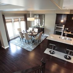 Dark hardwood, dark cabinetry and light gray. Love the light granite counter tops, stainless steal appliances and modern light fixtures Dark Kitchen Cabinets, Kitchen Cabinet Design, Dining Room Inspiration, New Kitchen, Kitchen Ideas, Kitchen Fixtures, New Home Designs, Model Homes, Home Kitchens
