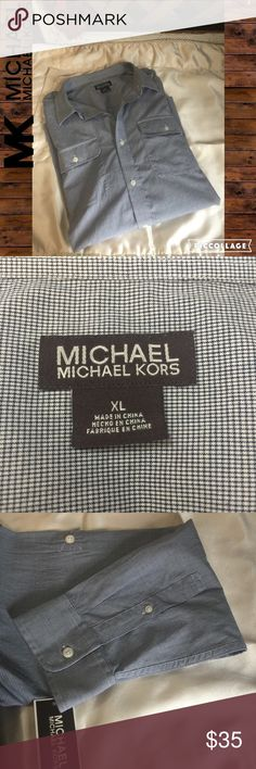 NWT Men's Michael Kors Relaxed Button Down, Sz XL 100% cotton button down from Michael Kors. NWT. Color is navy/white micro plaid. Sleeves can we worn down or rolled up and secured with attached tabs. Size is XL. Please feel free to ask questions or bundle for the best savings. I ship daily except Sundays. No trades please. Thank you! Michael Kors Shirts Casual Button Down Shirts