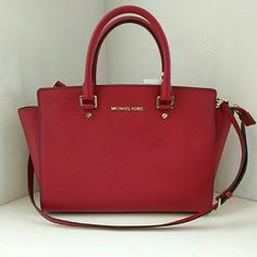 """Michael Kors LG Selma Saffiano Leather Satchel Red *Brand new, only comes with Nordstrom tag* A covetable top-handle satchel cast in scratch-resistant Saffiano leather provides fashionable elegance that stands the test of time. Top zip closure. Optional, adjustable strap. Interior zip, wall and cell-phone pockets; key clip. Protective metal feet. Logo-jacquard lining. Saffiano leather. 14"""" W x 9"""" H x 3-1/2"""" D. Double top hanldes with 5"""" drop; adjustable long strap with 22"""" drop. MICHAEL…"""