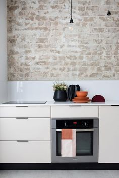 Ignore the actual colours and specific materials here, but the idea of the backsplash meeting brick is an interesting detail. Karen B Minimalistic Bauhaus Design Kitchen Bauhaus Interior, Loft Interior, Interior Design Kitchen, Kitchen Flooring, Kitchen Dining, Kitchen Decor, Kitchen White, Dining Room Wall Decor, Contemporary Interior Design