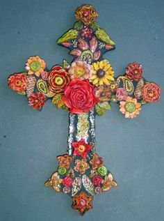 easter cross--time to ditch the carnations we use to adorn and go for this.