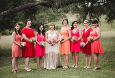 Colorful bridesmaids dresses - red, orange + pink mix-and-match, knee-length dresses {Nine Photography}