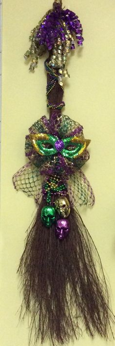 I decorated this cinnamon broom with some beads and ribbon topped with a small mask.