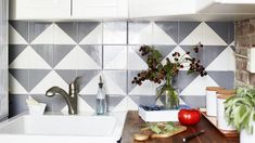 Update a tired tile backsplash with this paint trick. Vintage Ironing Boards, Decorating Your Home, Diy Home Decor, Diy Tile Backsplash, Candles In Fireplace, Paper Lampshade, Painted Stairs, Diy Chandelier, Hanging Racks