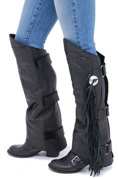 Fringed short chaps to protect your shins. A new biker fashion or a practical bug guard for your pant legs as you ride. Either way this attractive western style and fashionable leather shin chap covers your knee to your ankle. Stays in place with 3 w...