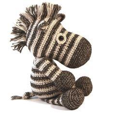 """Zebra haken. Deze stoere jongen heet Dirk de zebra. Het pakket bevat het het prachtige Stonewashed garen van Scheepjes en is verder helemaal compleet om direct mee aan te slag te gaan. Dirk wordt ongeveer 25 cm hoog en kan gehaakt worden met een 3,0 haaknaald Inhoud haakpakket Dirk de Zebra: Een duidelijk patroon met stap voor stap beschrijving en foto's. 50 gram Scheepjes Stonewashed """"Crystal Quartz"""",  50 gram Scheepjes Stonewashed """"Black Onyx"""", Vulling,  Veiligheids oogjes 10 mm"""
