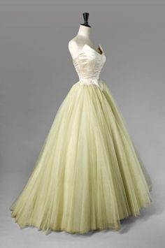 Balenciaga EISA haute couture evening dress, circa 1953. Ballgown made from duchess satin in strapless design champagne color with a rounded cutting edge appearing on each side, a reminder of the small Basque, long puff multilayer petticoat tulle silk skirt.  #Cristobal Balenciaga, #EISA was named after the designer's mother, a seamstress. #House of Balenciaga.