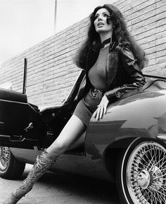 Low angle image of a woman stepping out of an E-Type Jaguar convertible sportscar, wearing a leather jacket, a minidress and laced cowhide boots. Coventry, Grand Prix, Jaguar Convertible, What's New Pussycat, Xjr, Jaguar E Type, Jaguar Xk, Cabriolet, Best Muscle Cars