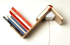 LILILITE is a minimalist design created by Netherlands-based designer Thijs Smeets. LiliLite is the ultimate bed lamp. It's a reading light, a bookshelf and a bookmark ingeniously combined into one smart product. LiliLite uses plywood and energy efficient LED lighting. It's easy to mount it to the wall. It's even possible to mount two LiliLite's mirrored above a double bed. (1)