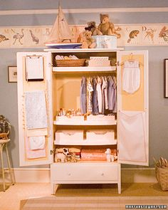 Repurposed entertainment center/armoire. Space for hanging clothes, hanging blankets, and bins for small item storage. ...could be used for entryway when you don't have a coat closet...