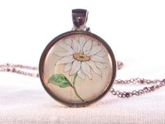 Check out this item in my Etsy shop https://www.etsy.com/listing/194049903/april-birth-month-flower-daisy-pendant