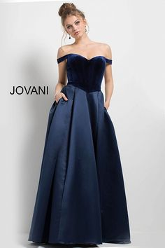 Floor length navy evening ballgown features satin full skirt with pockets and velvet off the shoulder sweetheart neckline bodice.