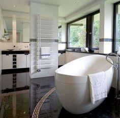 Really like the shape of the bath. And anice light through the big windows.