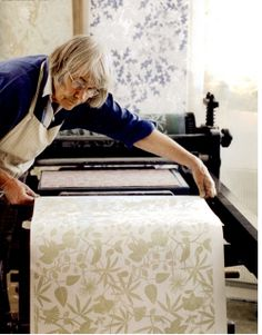 Marthe Armitage making her wallpaper.