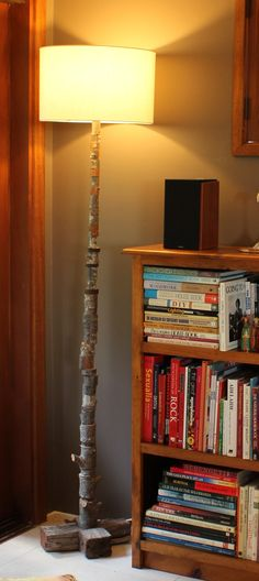 Kebab Lamp 1: Slices of tree trunk threaded onto a pole. Base made from recycled floor joists.
