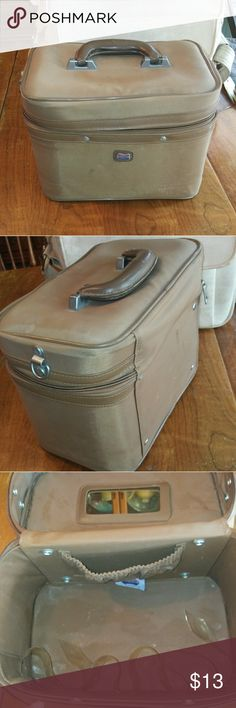 Vintage train case/makeup case/luggage Light brown 50's American Tourister train case. Has an adjustable plastic piece inside that you can make larger or smaller to fit whatever you want to put in there securely. It has definitely been used. Some spots and a crack in the handle (price will reflect those) still an awesome piece.. Even just to keep your everyday makeup in and still keep that vintage pinup vibe 💋 American Tourister Bags Travel Bags