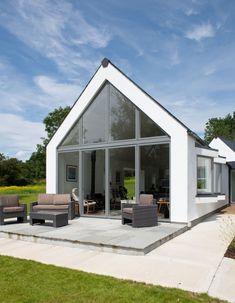 Wooden Door Design, Wooden Doors, Flat Roof House Designs, House Designs Ireland, Thermal Mass, Adaptive Reuse, River House, Concrete Floors, Building Materials