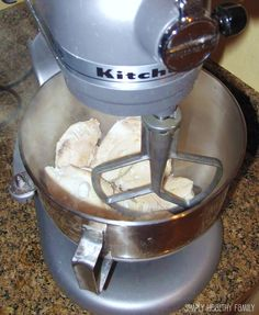 This totally works!  Put freshly cooked, still hot chicken breasts in the mixer with the paddle attachment and mix on medium for 15-20 seconds, shreds it perfectly!