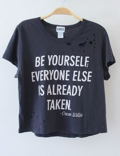 "RESTOCKED May 1!    One of a kind distressed crop tee from quality brand SCRATCH!     Charcoal gray crop tee has a super soft, worn-in feel with Oscar Wilde quote graphic on the front: ""BE YOURSELF, EVERYONE ELSE IS ALREADY TAKEN."" Tee has vintage-inspired distressed holes all over.    **Shirts a..."
