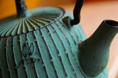 The Japanese Tea Ceremony, also known as The Way of Tea, is the ceremonial process of preparing and presenting matcha (powdered green tea). Tea is documented as early as the 9th Century in Japan! Image Credit: 'Japanese Cast Iron Tea Kettle March 13, 20105' by Steven Depolo under CC BY 2.0.